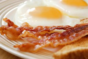 Bacon and fried eggs on plate