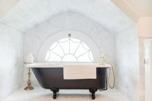 Bathtub in front of round window