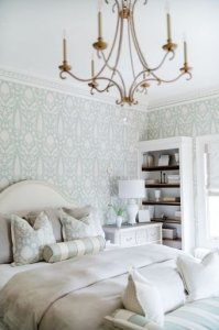 King bed next to bookshelf