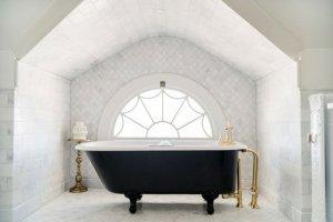 Bathtub in front of round window
