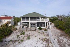 Sandy back yard near beach house