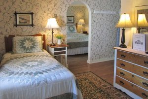 Bed next to dresser in bedroom