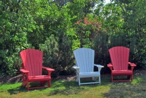 Lawn chairs infront of bushes