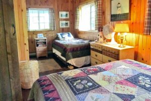Bed across from windows and twin bed