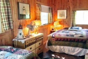 Dresser between beds in bedroom
