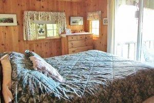 Bed across from window in room