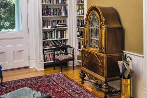 Bookshelves by front doorway