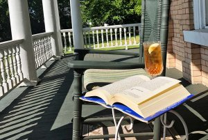 Book and chair on porch