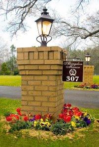 Sign on stone pillar along road