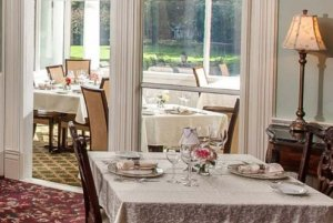 Tables set in dining room next to window