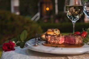 Steak dinner and glasses outside