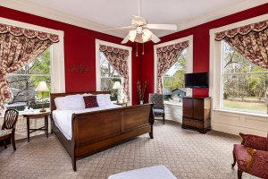 Sleigh bed next to windows