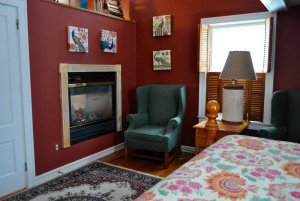 View of chair next to fireplace