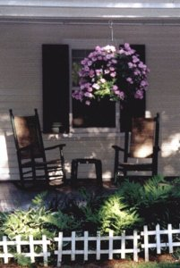 Outside sitting chairs with hanging flower pot