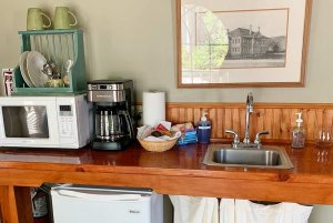 kitchenette with microwave, coffe maker, and sink