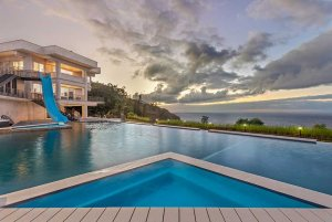 Pool and estate at sunset