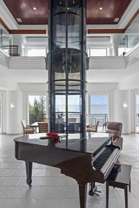 Grand piano and glass elevator