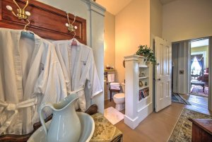 View of bath robes and the bathroom