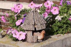 Little wood house near purple flowers