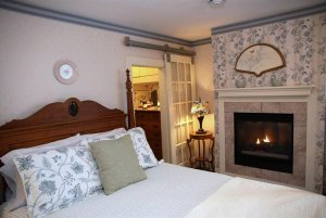 View of the bed and fireplace