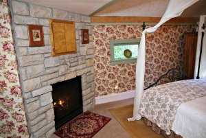 View of fireplace and bed