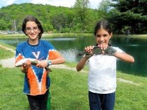 young kids holding caught trout fish