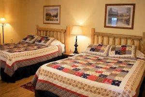 two queen beds in cabin bedroom