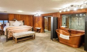 Bed and copper soaking tub