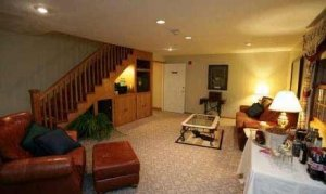 Room with couch, coffee table, and armchair