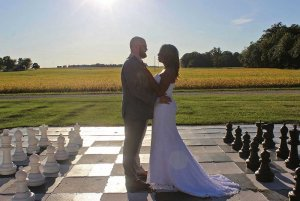 bride and groom on giant chess board