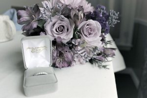 wedding band and bouquet of flowers