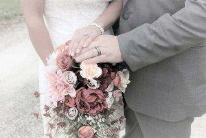 bride and groom showing rings