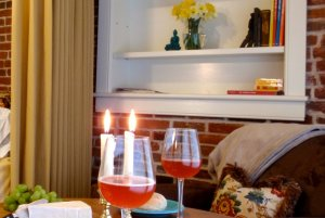 wine glasses and appetizers on bedside table