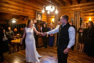 Bride and groom holding hands on the dance floor