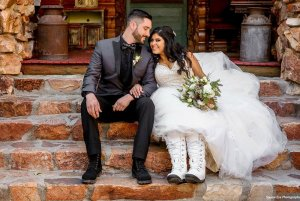Bride and groom sitting on porch steps