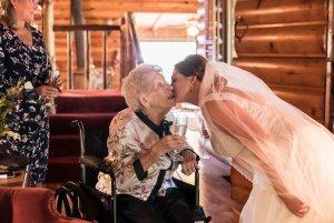 Bride kissing an elderly woman