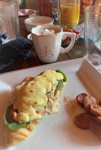 Breakfast dish near cups of hot beverages