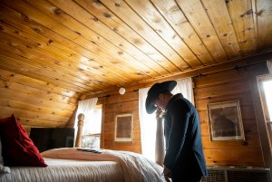 Groom preparing for ceremony in bedroom