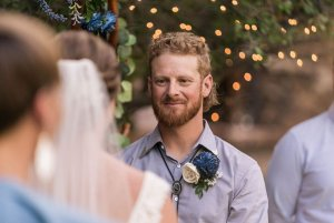 Groom smiling at bride during wedding cermemony
