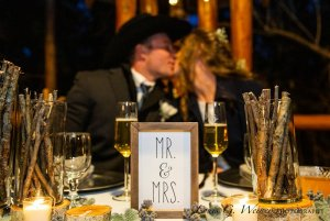 Bride and groom seated at a dining table