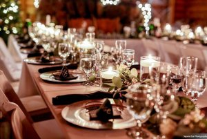 Dining table laiden with decorative place settings