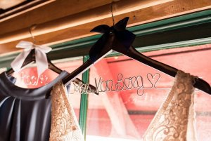 Wedding dresses hung up by a window
