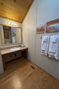 Bathroom sink and mirror next to towel rack