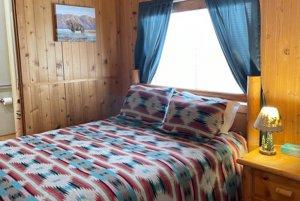 Bed infront of window in bedroom