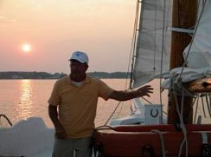 Black Walnut Point Inn Captain Wade on sailboat