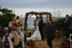 Black Walnut Point Weddings bride and groom kissing at the altar