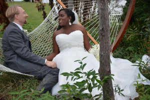 Black Walnut Point Weddings bride and groom sitting on hammock