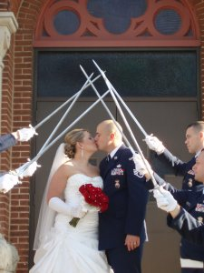 Chapel of the Archangels bride and groom kissing soldiers holding swords