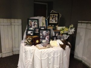 Chapel of the Archangels table with photos and memories of couple
