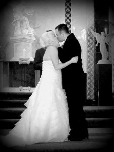 Chapel of the Archangels bride and groom kissing at altar